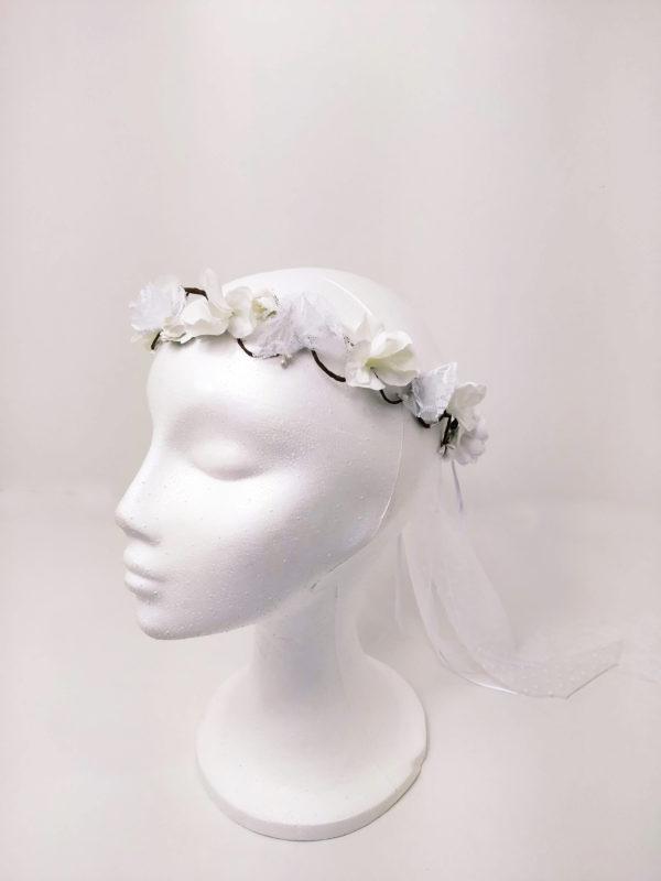 Corona trenzada flores blancas